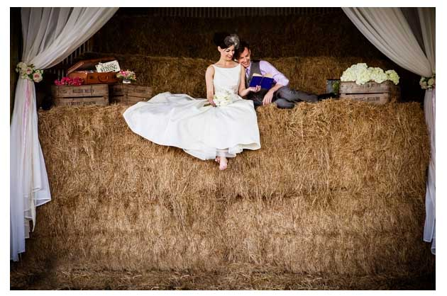 rustic wedding bride and groom in a barn, in haystack - wedding photographer leicestershire Lumiere Photography