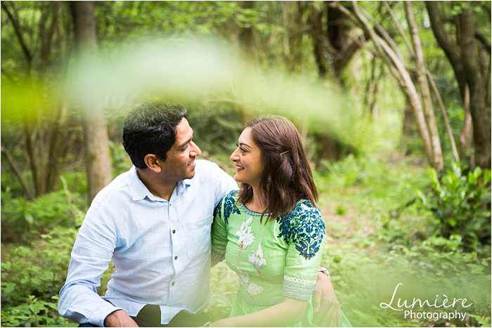 asian couple at pre-wedding photography session in Loughborough's woods