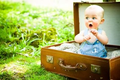 baby in suitcase photo by lumiere photography loughborough