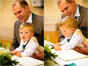 wedding ceremony photography boy signing the register
