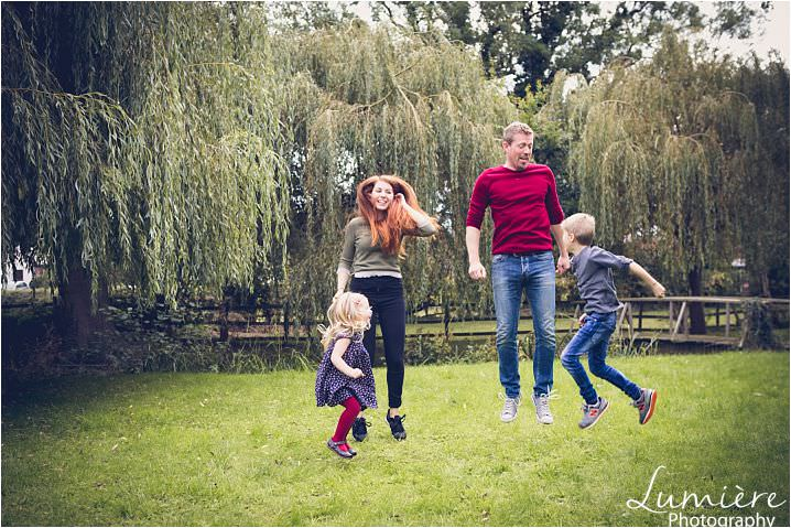 family portraits photography in leicester: family jumping in the air