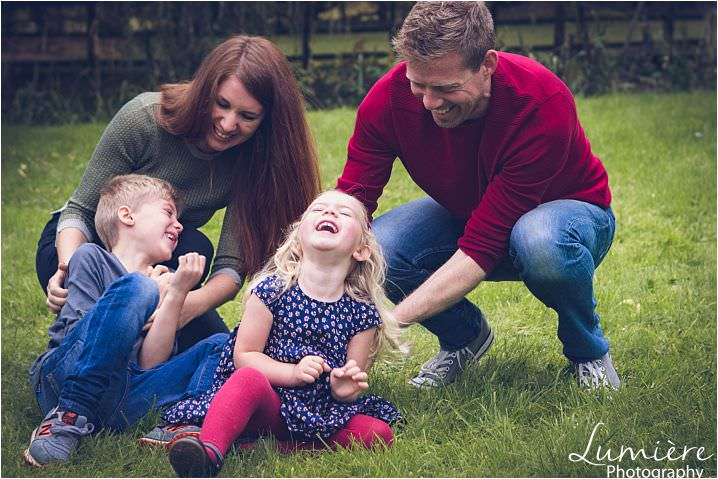 family photography in leicester Parents tickling children