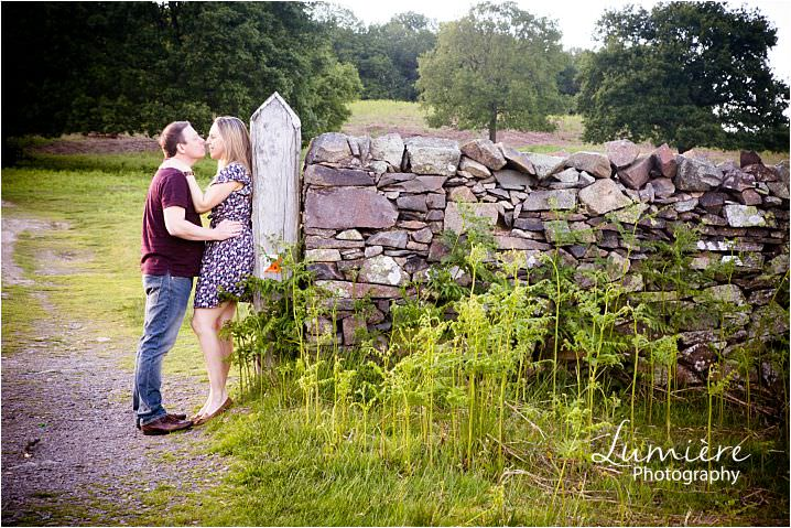 couple kissing at Engagement photography at Leicester's Bradgate Park