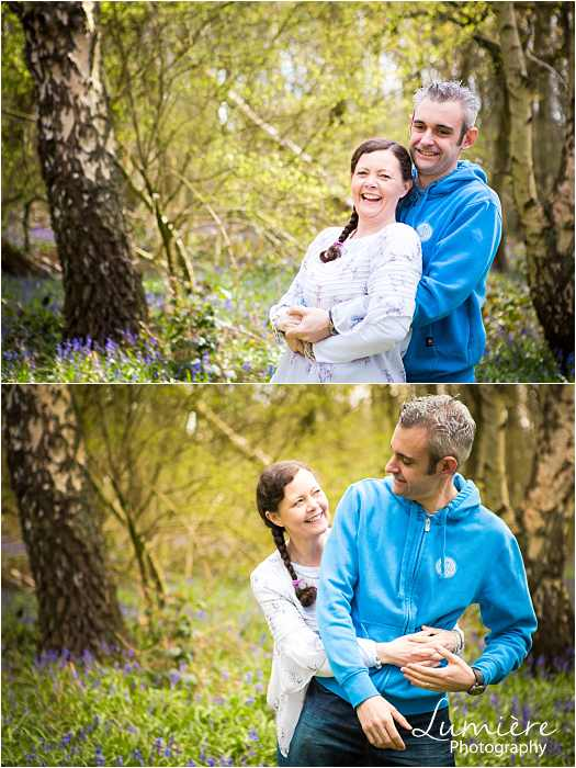 Family photographer in Leicestershire parent's showing how to hug at family photoshoot in loughborough