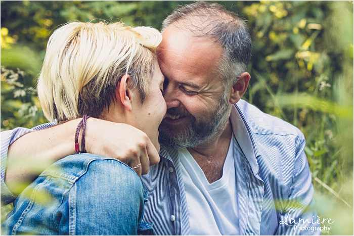 couple embrace in Nottingham pre wedding photographer's shoot
