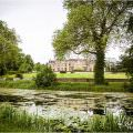 Northamptonshire Rushton hall wedding venue view from the lake in landscape