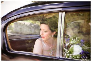 bride arriving at Beaumanor Hall for art deco wedding in vintage car