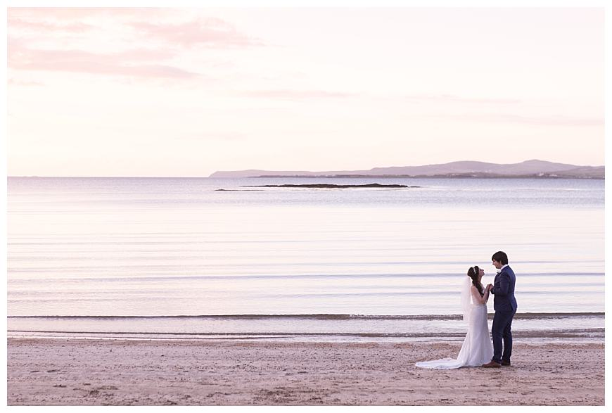 Anglesey wedding with couple at penrhos beach at sunset