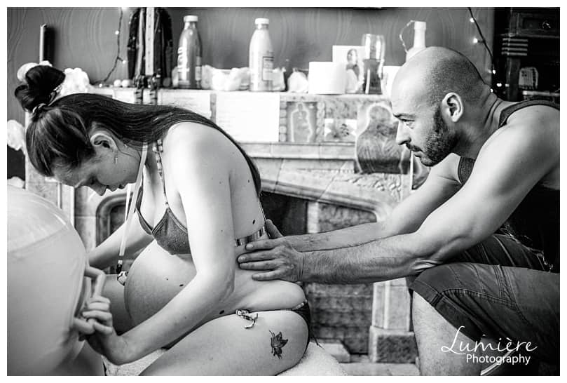 birth photography- woman in labour with her partner at home