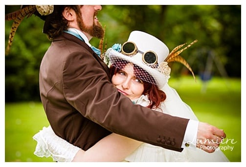 wedding photography Leicester- bride squeezing groom at steampunk wedding