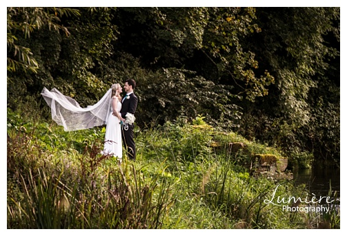 Wedding photography Leicester- bride and groom by the river
