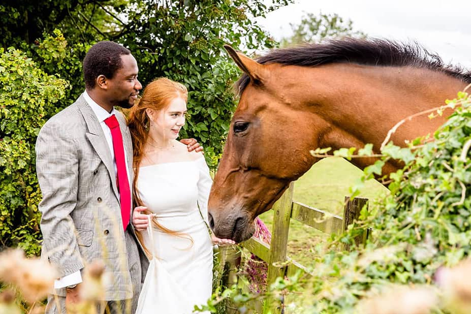 wedding photographer Leicester- bride and groom with horse
