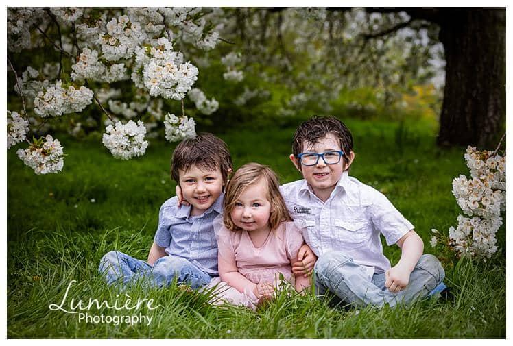 children portraits in cherry blossoms